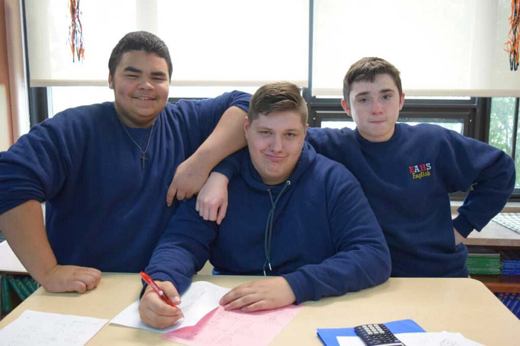 classmates pause from class work to pose for picture
